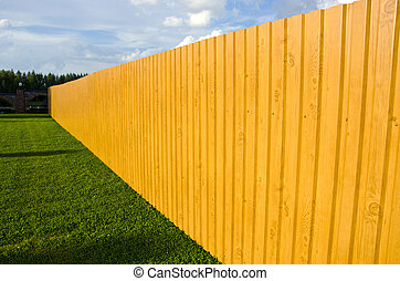 new wooden fence in farm - new wooden and painted fence in...