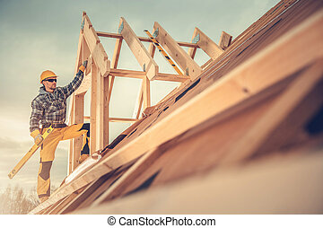New Wooden House Construction Worker