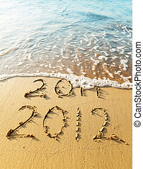 New Year 2012 is coming concept - inscription 2011 and 2012...