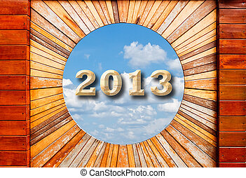 new year 2013 concept in Vintage wood pattern texture with blue sky background
