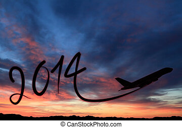 New year 2014 drawing by airplane on the air at sunset