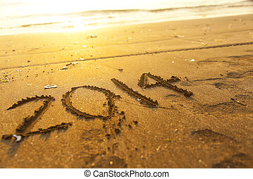 New year 2014 number on sand