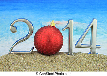 New year 2014 with Christmas ball on the beach