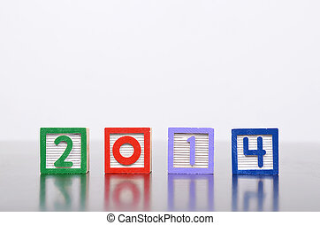 New Year 2014 word formed by wood alphabet blocks