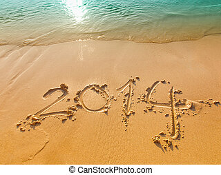 New Year 2014 written in sand on the beach