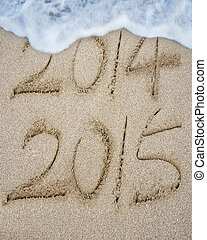 New year 2015 replace 2014 on sand beach