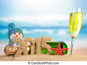 New year 2015 sign with champagne, snowman on the beach...