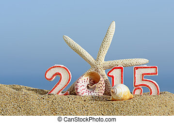 New year 2015 sign with seashells and starfish on a beach sand