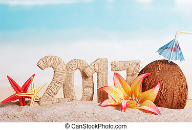 New Year 2017 inscription, coconut, starfish and flowers on...