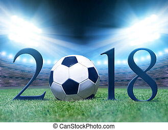 New Year 2018 concept. Soccer ball in grass on football...
