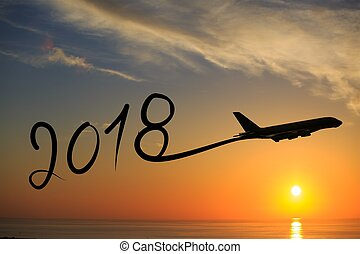 New year 2018 drawing by airplane on the air at sunrise