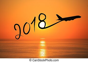 New year 2018 drawing by airplane on the air at sunrise -...