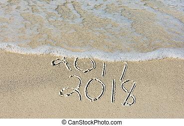 New Year 2018 in beach sand