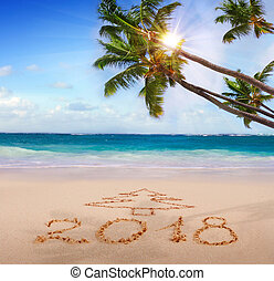 New Year 2018 written on sandy beach. - New Year 2018 is...