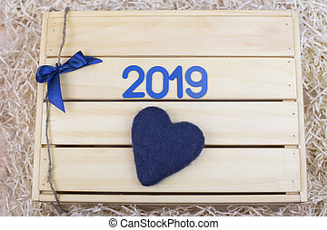 Blue symbol with number 2019 and a heart on a wooden box