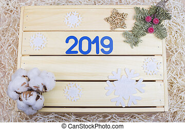 Blue symbol with number 2019 and new year decor on wooden background