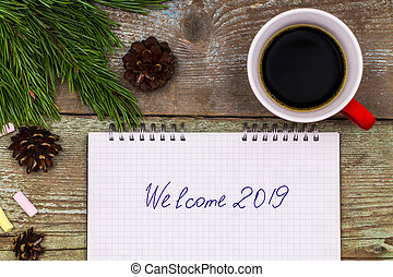 New Year 2019 concept. notebook on wood table writing Welcome 2019