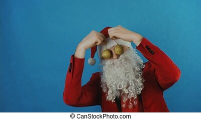 New year 2019, man like a Santa with golden Christmas balls baubles toys, on blue background