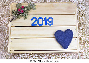 New Year's decor on a wooden background.