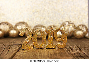 New Year 2019 numbers and baubles with glittery background
