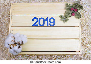New Year 2019. Symbol with number 2019 and new year decor on background