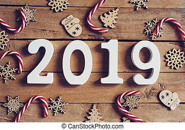 New year 2019 word and Christmas decoration on wooden table. Business concept.
