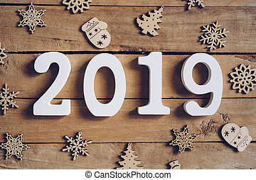 New year 2019 word and Christmas decoration on wooden table. New Year concept.