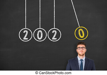 New Year 2020 Energy Concepts over Human Head on Blackboard Background
