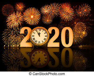 2020 happy new year fireworks with old clock face