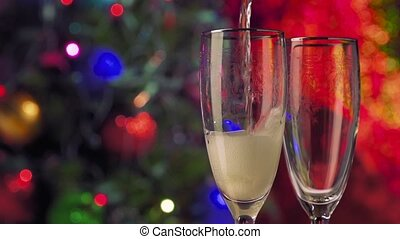 New Year and Christmas Celebration. Champagne Glasses over Blinking Background