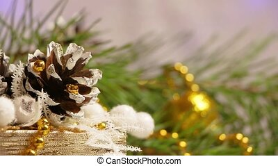 new year and christmas decoration in the shape of a pine cone and flashing garland