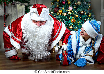 New year and Christmas greetings. Funny snow maiden and Santa Claus. Russian holiday.