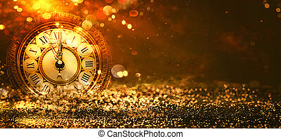 New Year Background. Clock countdown. golden Holiday abstract defocused Background With glowing Stars. Blurred Bokeh. Blurred background