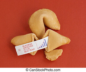 New Year Business Fortune - Two fortune cookies on a red...