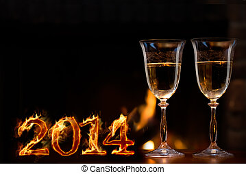 New Year Celebration 2014. Two champagne glasses in front of...