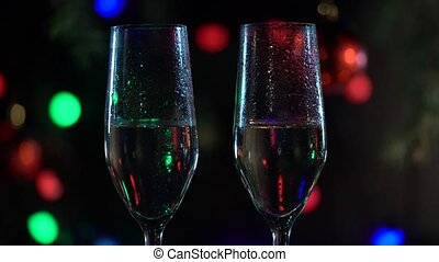 New Year celebration with two champagne glasses. Close up -...