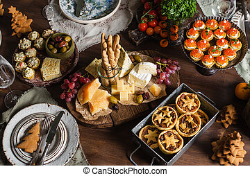 New year, christmas or festive table table with food top view. 2021
