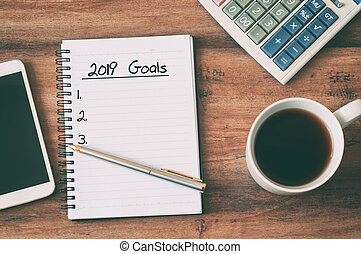 New year Concept - 2019 goals text on notepad