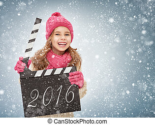 new year concept. - child girl in winter clothes holding...
