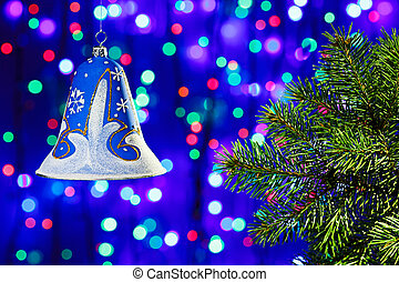 New Year decorations bell on multicolor circles bokeh background