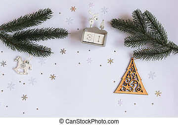 New year flatley layout with snowflakes, twigs of a green Christmas tree on a white background and a place for your inscription