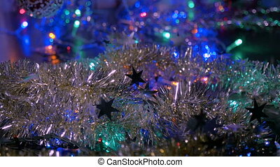 New Year garlands. Multicolored flashlights flash. Move the camera around the object.