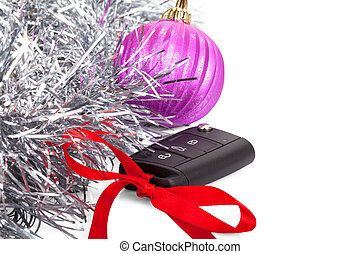 New year gift with car key and red bow isolated on white background