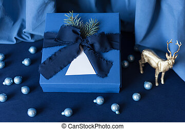 New Year gifts, blue box on blue background with winter ...