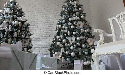 new year gifts under white Christmas trees -1