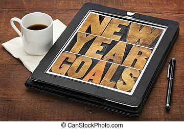 New Year goals on digital tablet - New Year goals -...