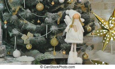 new year handmade toy angel on christmas tree spining