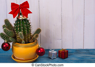 New Year in tropical hot climate concept. Cactus as christmas tree with toy and gift boxes