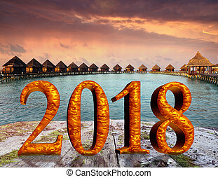 New Year inscription 2018 on the wooden road over the sea