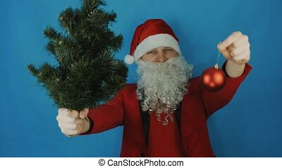 New year, man like a Santa Claus with Christmas tree and red ball bauble toy, on blue background